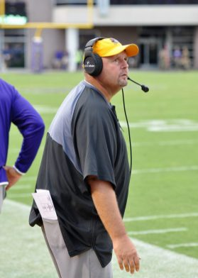 ECU defensive coordinator David Blackwell glances at the scoreboard early in the fourth quarter. (Photo by Al Myatt)