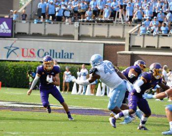 East Carolina quarterback Reid Herring carries on a designed run. (Photo by Al Myatt)