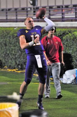 True freshman quarterback Holton Ahlers warms up before giving the Pirates a much-needed offensive spark. (Photo by Al Myatt)