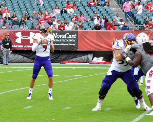 East Carolina quarterback Reid Herring looks downfield in Saturday's American Athletic Conference matchup with Temple. (Photo by Al Myatt)
