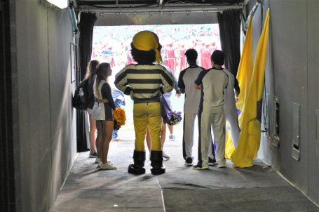 The Pirate mascot and cheerleaders look out from the tunnel where ECU entered Lincoln Financial Field. (Photo by Al Myatt)