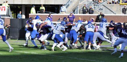 #2 of 3-photo sequence: Tony Pollard cuts behind teammate Scottie Dill and scores on a 1-yard run. (Photo by Al Myatt)
