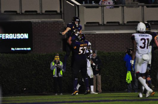 Freshmen Tyler Snead (22) and Peyton Winstead (57) celebrate after Snead's third touchdown reception of the evening. (Photo by W.A. Myatt)
