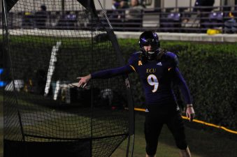 Kicker Jake Verity alerts the Pirate equipment staff that he put a hole in the practice net on the ECU sideline. (Photo by W.A. Myatt)