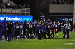 The Pirate sideline erupts after a late interception by defensive back Damel Hickman. (Photo by W.A. Myatt)