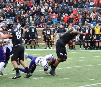 Devon Sutton makes a stop for East Carolina on Saturday at Cincinnati. (Photo by Al Myatt)
