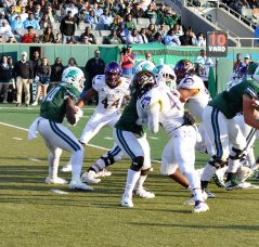 ECU defenders Kendall Futrell (44) and Nate Harvey contain Darius Bradwell of Tulane. (Photo by Al Myatt)