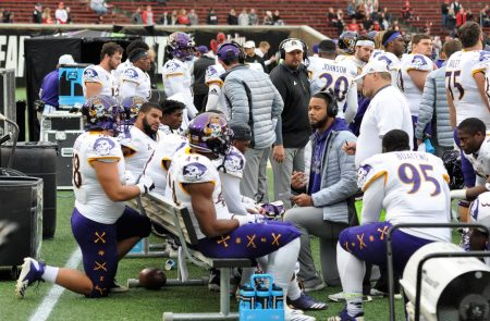 ECU defensive line coach Rodrique Wright talks to players on the sideline. (Photo by Al Myatt)
