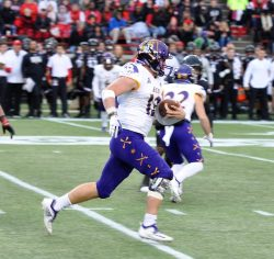 ECU quarterback Holton Ahlers gets yards on Saturday at Cincinnati. (Photo by Al Myatt)