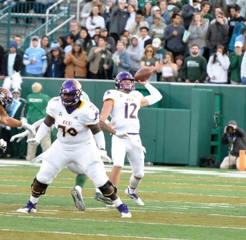 Holton Ahlers passes for the Pirates on Saturday at Tulane. (Photo by Al Myatt)