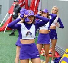 The ECU cheerleaders put on caps as rain began to fall at Carter-Finley Stadium on Saturday.