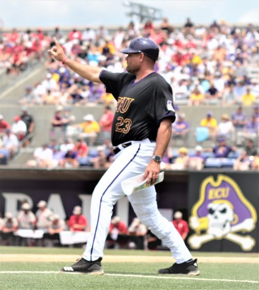 ECU coach Cliff Godwin gives the signal to a runner at second base. (Photo/Dunn Area Sports/Paul Burgett)
