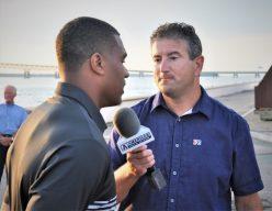 Andy Katz (right) interviews Cincinnati linebacker Bryan Wright for the American Digital Network. (Photo by Al Myatt)