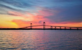 A colorful sunset is the background for the Claiborne Pell Bridge into Newport, RI. (Photo by Al Myatt)