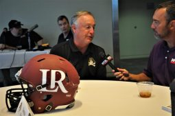 Offensive coordinator Donnie Kirkpatrick said the Lenoir-Rhyne helmet was 'too new' to be his. Kirkpatrick was a four-year letter winner for the Lenoir-Rhyne Bears from 1978-81. (Photo by Al Myatt)