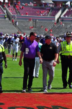 ECU athletic director Jon Gilbert (left) and first year head coach Mike Houston exchange thoughts walking off the field at Carter-Finley Stadium following a 34-6 season opening loss in-state opponent NC State. (W.A. Myatt photo)