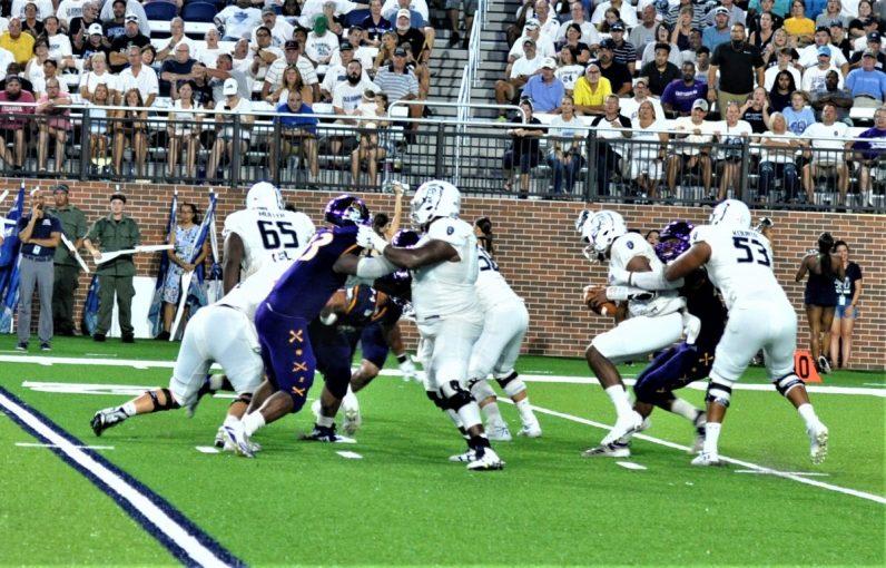 ECU defensive end Kendall Futrell gets to ODU quarterback Stone Smartt on a third down. (Photo by Al Myatt)