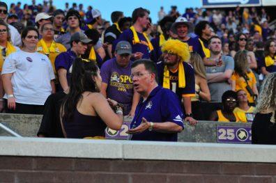 ECU interim chancellor Dan Gerlach interacts with fans during Saturday night's home opener against Gardner-Webb. (W.A. Myatt photo)