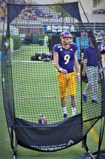 Jake Verity got some practice in the net on the sideline before kicking s 31-yard field goal in the second quarter (Photo by Al Myatt)