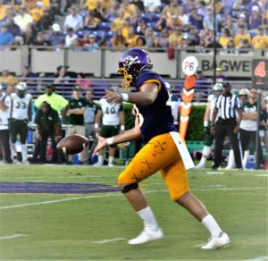 Punter Jonn Young puts his foot to the football for the Pirates (Photo by Al Myatt)