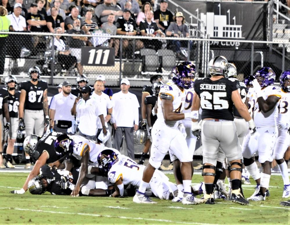 East Carolina defenders get a UCF ball carrier on the ground (Al Myatt photo)