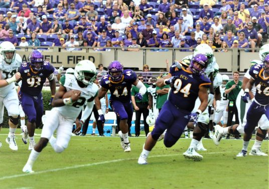 USF quarterback Jordan McCloud's gain on this play was nullified by holding. (Photo by Al Myatt)