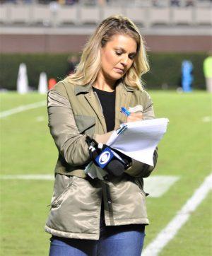 CBS Sports Network sideline reporter Amanda Balionis makes notes during halftime (Al Myatt photo)
