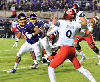 Cincinnati quarterback Desmond Ridder releases a pass as Chance Purvis (46) closes in for ECU (Al Myatt photo)
