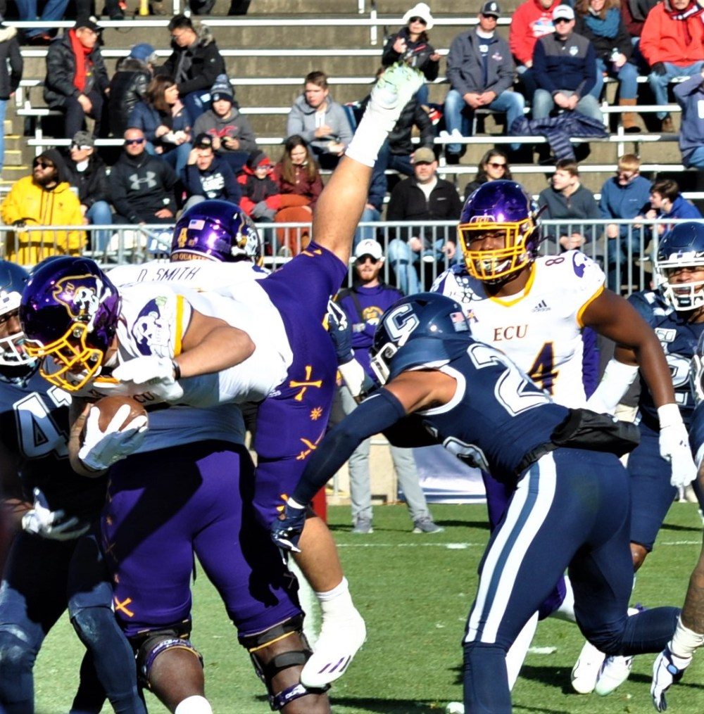 Darius Pinnix Jr. leaped into the end zone for ECU's first touchdown at UConn. (Photo by Al Myatt)