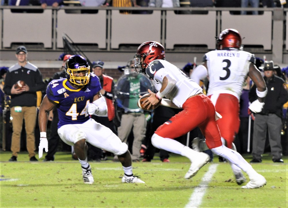ECU defensive end Kendall Futrell (44) made the stop on Cincinnati quarterback Desmond Ridder on this play (Al Myatt photo)