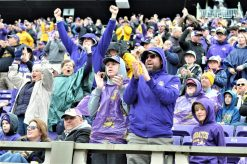 East Carolina fans react to an early fourth down stop by the Pirates. (Photo by Al Myatt)