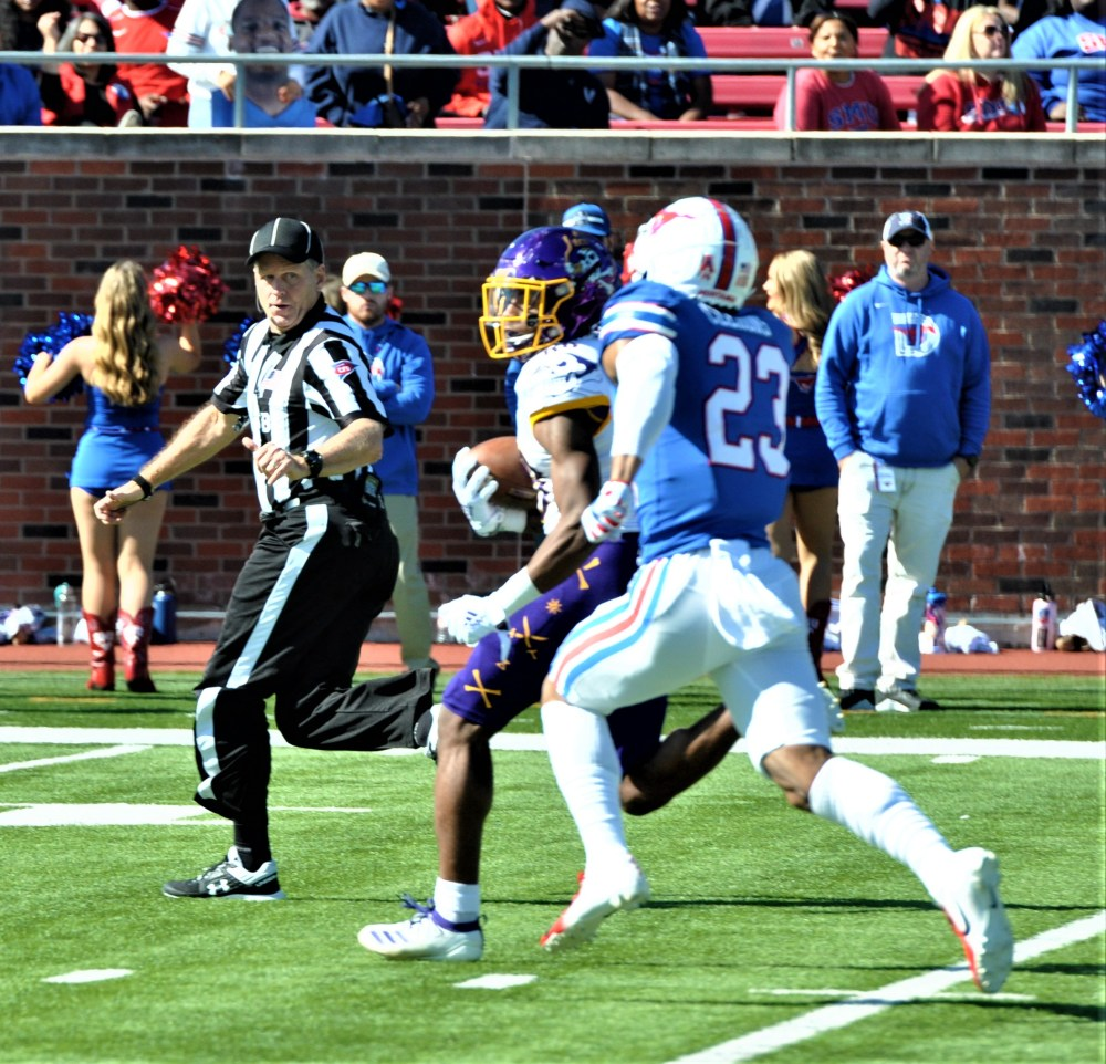 Jsi Hatfield of the Pirates has a step on an SMU defender en route to the end zone. (Photo by Al Myatt)