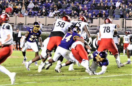 Kendall Futrell (44) stops a Bearcat ball carrier at the line of scrimmage (Al Myatt photo)