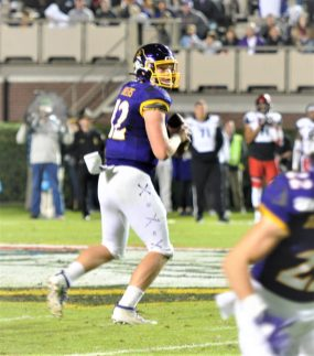 Pirate quarterback Holton Ahlers looks downfield on Saturday night at Dowdy-Ficklen Stadium (Al Myatt photo)