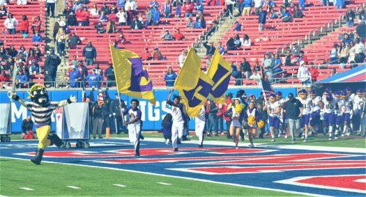 The Pirates take the field on Saturday at Gerald J. Ford Stadium. (Photo by Al Myatt)