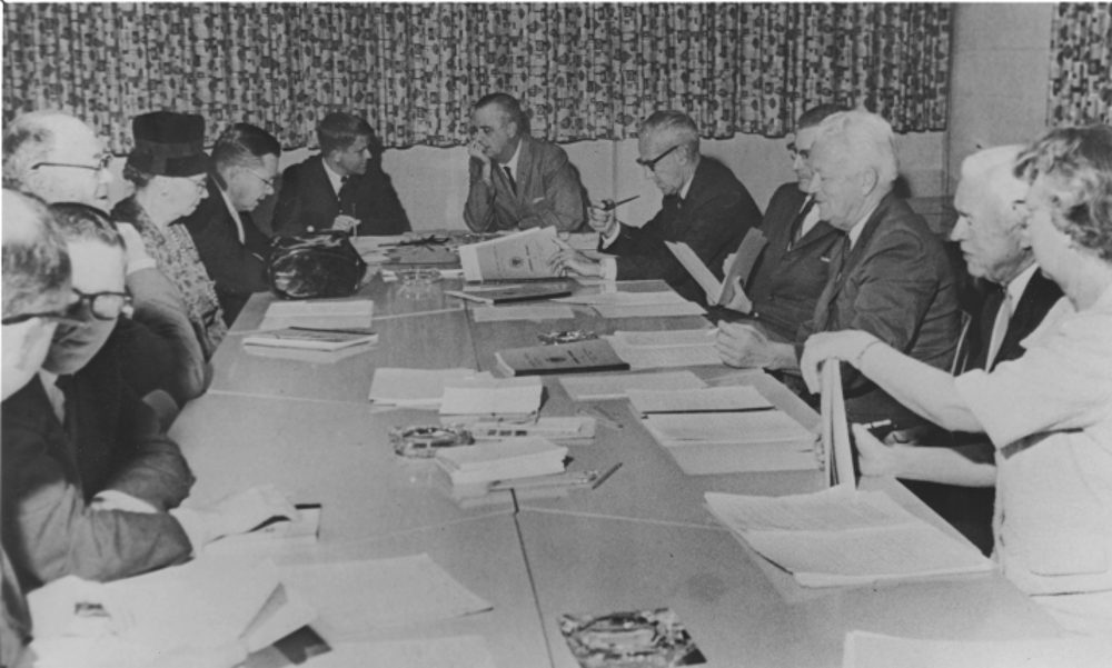 While in the state legislature, Morgan became the first alumnus to serve on the East Carolina Board of Trustees. This photo (ca. 1964) from The Buccaneer is of one of the meetings of the Board of Trustees. (Left to right): two unidentified men, Henry Oglesby, Mrs. Belk, unidentified man, Robert Morgan, Leo Jenkins, William Blount, unidentified man, Fred Bahnson, Irving Carlyle and Agnes Barrett. (ECU Archives Photo)