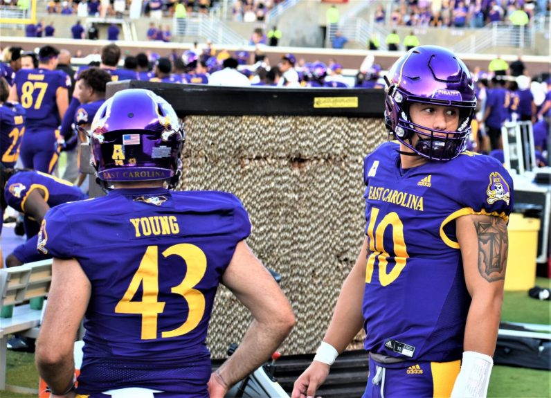 Jonn Young punted just once Saturday. Mason Garcia (right) came in to throw a touchdown pass in the fourth quarter. (Al Myatt photo)