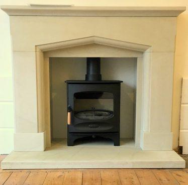 Charnwood C Four wood burning stove with sandtone surround installation