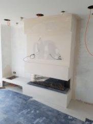 Inset fire with false chimney breast