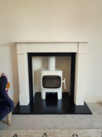 Jotul F105 wood burning stove with a victorian classic surround