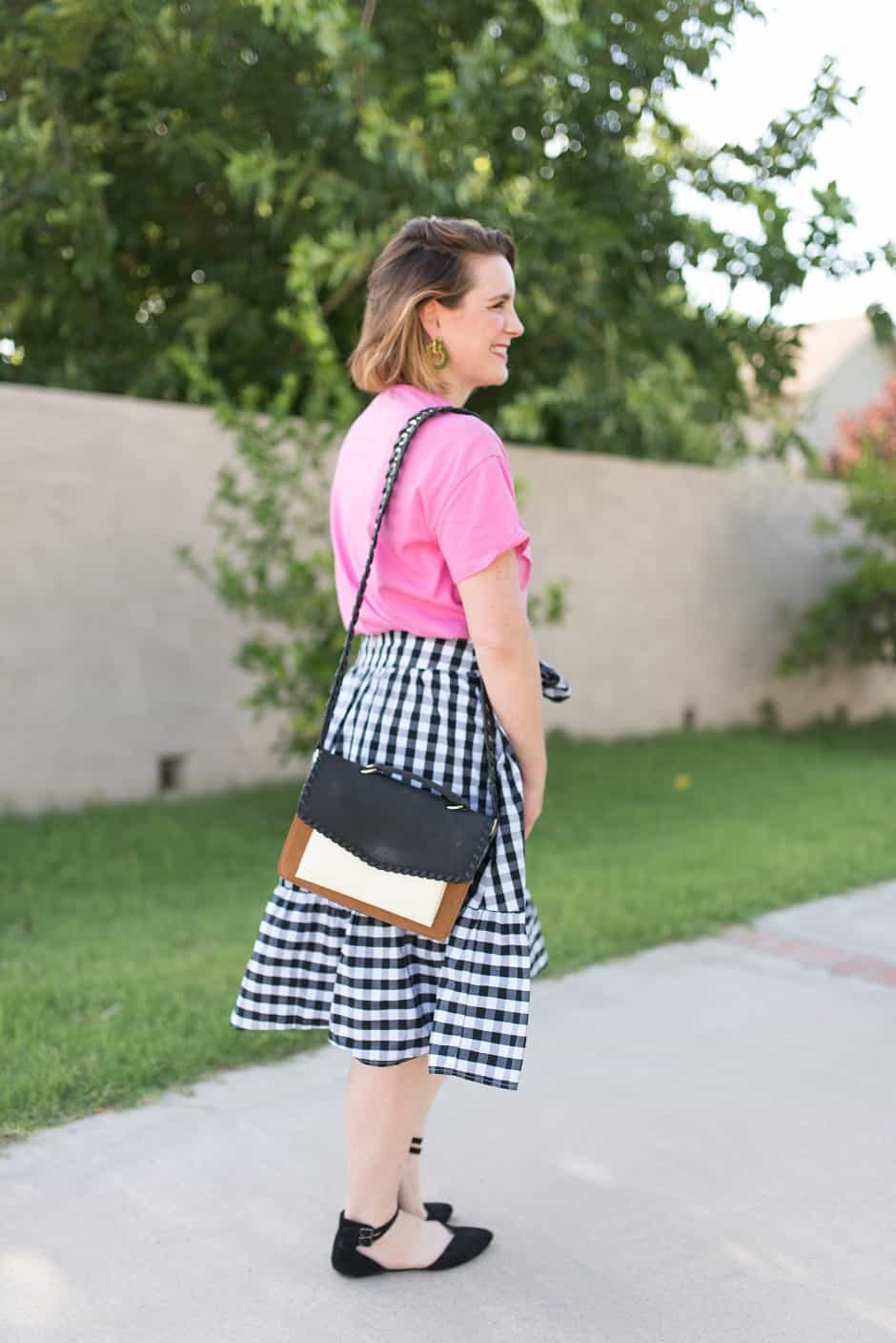 Gingham is still going strong as a trend in women's clothing and we're loving it! But it's not always easy to figure out what to wear with it. Read on for tips on how to style a gingham skirt and ensure you keep it looking grown up!