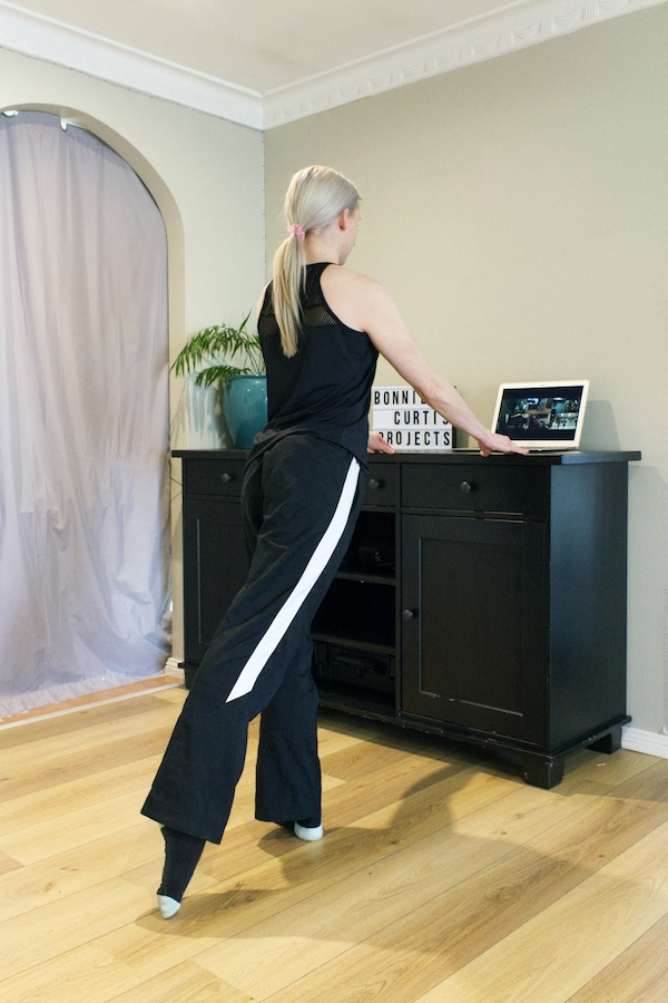Dancer Taking An Online Class With Her Leg Pointed Behind Her