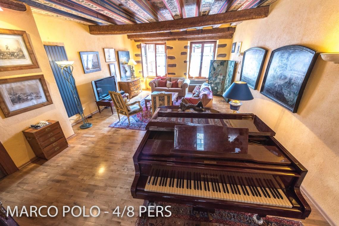 Le Marco Polo à riquewihr - appartement 5 étoiles le salon avec piano