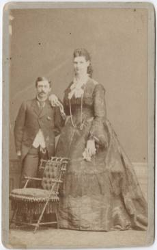 Photograph_of_circus_performers;_a_giant_woman_and_a_man