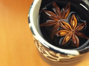 tea cup with whole Star Anise pods