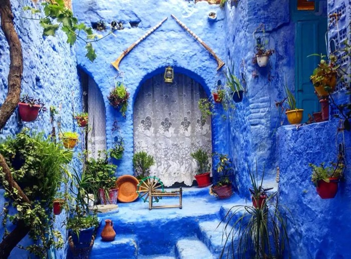 Blue door, walls, and steps in Chefchaouen, Morocco