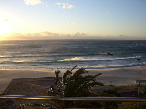 Waves roll in from the Atlantic onto the beach at Camps Bay, South Africa: A favourite holiday reading spot