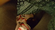 Sleeping under the blankets.