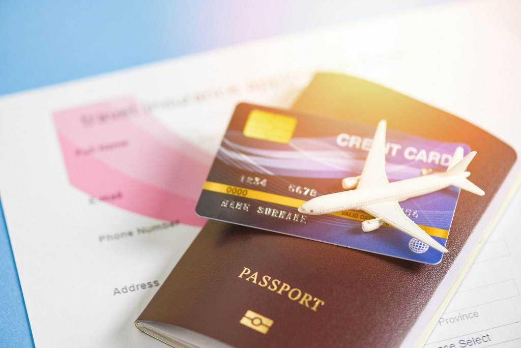 Travel insurance application form with passport credit cards by Booking express travel