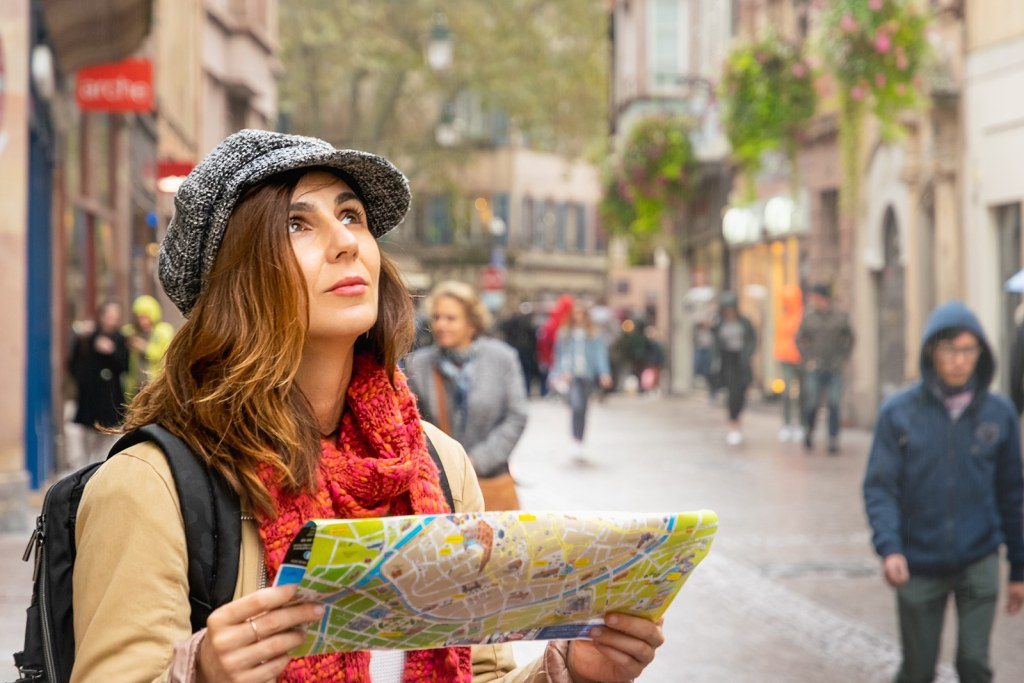 tourist using a map by Booking Express Travel